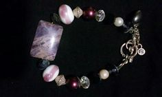 Women's protection bracelet. Amethyst, silver, jet, clear quarts, and vintage beads $40