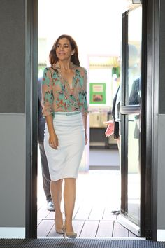 flower blouse and white skirt