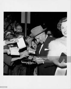 Actor and comedian Jimmy Durante signing autographs for fans, as he arrives at the premiere of the movie 'White Christmas', 1945.