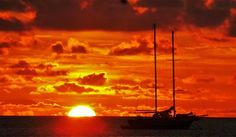Sunset sailboat in maldives Photo by Dean Howlett -- National Geographic Your Shot