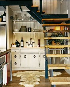 Cosy Kitchen Inspirations in New York. I would be concerned about the dirt and dust from the stairs floating down into the kitchen, gross. Home, Home Kitchens, Kitchen Design, Tiny Kitchen, Kitchen Places, Eclectic Kitchen, Lake House Kitchen, Kitchen New York, Cosy Kitchen