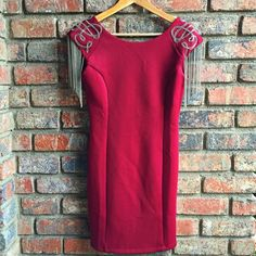 Edgy dress New with tags burgundy dress with detailed sequin design on shoulders and draping silver chain links. Zip closure at the back. Moon Collection Dresses