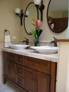 Dark cabinet with dark mirrors & light tile
