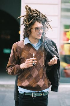 "Something classic about a man with a classic pipe! And now dreadlocks too! This ""Untitled"" 2009 pic is by aorist on Flickr."