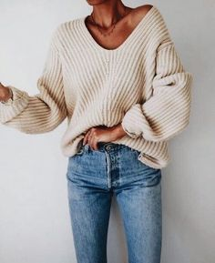Oversized off white sweater with blue jeans.