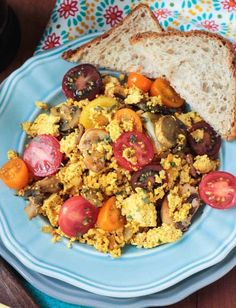 Easy Tofu Scramble with Mushrooms - a hearty, protein packed, plant based breakfast to get you through your day. Plenty of spices means no boring tofu here!
