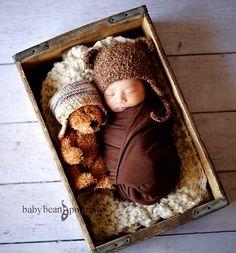 Newborn infant sleeping in a cradle
