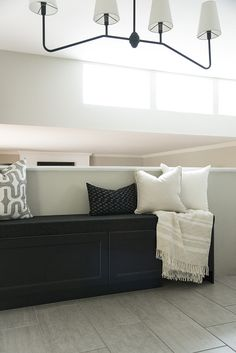 Looking for an easy, affordable IKEA hack that looks anything but cheap... this storage banquette DIY is for you! It's perfect in a kitchen or nook.