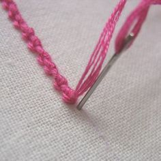 Palestrina stitch, which is also called old English knot, double knot stitch, and tied coral stitch, creates a line of raised knots that is useful for creating outlines and borders. The secret is to keep your knots evenly spaced and fairly close together. Here's a tutorial with great step by step photos