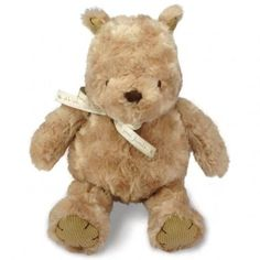 "This adorable 9"" bundle of a bear is sure to amuse and entertain your baby! She'll love snuggling with this silly ole bear and exploring his soft fluffy coat, his corduroy accents and his grosgrain bow. Pooh is super-soft and made from 100% Polyester."