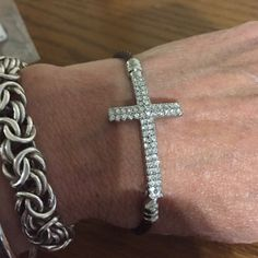 Crystal Cross bracelet This is a really cool bracelet-  the cross is done in nice clear crystals and the band is twisted stainless steel. What I'm struggling with is the color. It's sort of a brownish purpleish bronze?   Great piece! Jewelry Bracelets