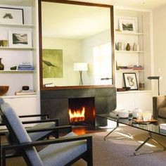 large mirror over fireplace but would match fireplace surround in dark wood panel