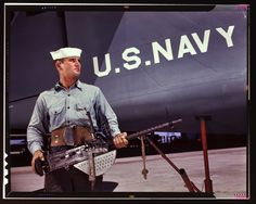 """August 1942. Corpus Christi, Texas. """"After seven years in the Navy, J.D. Estes is considered an old sea salt by his mates at the Naval Air Base."""" 4x5 Kodachrome transparency by Howard Hollem, Office of War Information."""