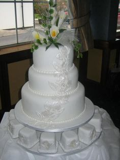 Arum Lilies Wedding Cake  ~ Satin Rose work on the   cake was hand done.