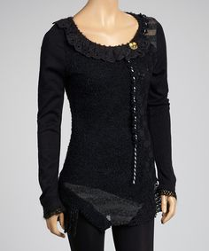 LV266, The pattern of patchwork bring a unique European look to this long sleeve top with a ruffle finishing the round neckline.