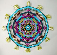 Cassie Stephens: The Weaving Series: God's Eye (Ojo de Dios) . This one is by artist, Jay Mohler. It is over the top! Gorgeous!