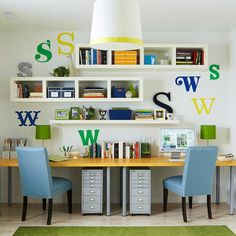 cheery office space...love the open shelves, matching blue chairs, large letters