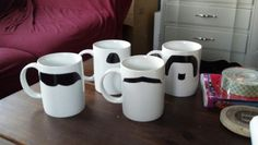 Mustache mugs i made for a Christmas present this year using hand drawn stencils, an exacto knife, a self healing mat, contact paper, and a porcelain pen...all that's left is to bake them do they are dishwasher safe!