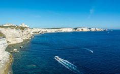 Cliffy coast of Bonifacio, Corsica. Right over the horizon are the misty shapes of Sardinia.