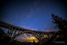 """""""Milky Way over Donner Pass"""" by Mark E Loper, Folsom, CA // This is Old Rainbow Bridge on the old US Hwy 40, also known as the Lincoln highway, crosses over Donner Pass in the Sierra Nevada. // Imagekind.com -- Buy stunning, museum-quality fine art prints, framed prints, and canvas prints directly from independent working artists and photographers."""