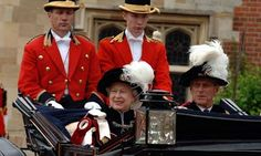Queen Elizabeth II and Prince Philip leave in an open carriage following the annual Order of the Garter Ceremony at St. George's Chapel in 2007. Queen Elizabeth II has reigned since 1952.