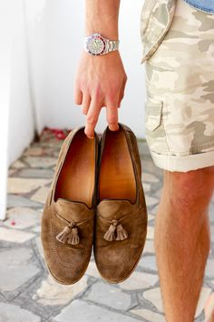 Pair loafers with rolled up shorts for a cool summer look.