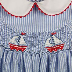 DRESS SAILBOATS WITH RED RICK RACK