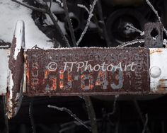 Title: 50-643 By: JTPhotoArt  Description: The elements have weathered this old license plate in Northwestern North Dakota