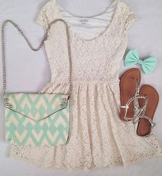 Love the dress! The lace is so pretty and can be dressed up or dressed down to be able to wear to many occasions. I also the the mint in the bow and the bag. It really pops against the dress and pulls the outfit together.
