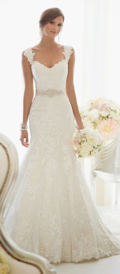 This is beautiful - It has lace! It has sparkle! It has beautiful little sleeves!! If it has a relatively long train it would be perfect!