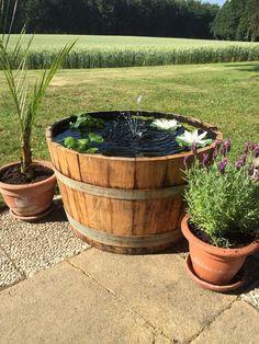Weinfass als Miniteich für den Garten / little pool for the garden by Fass-Schmiede via DaWanda.com