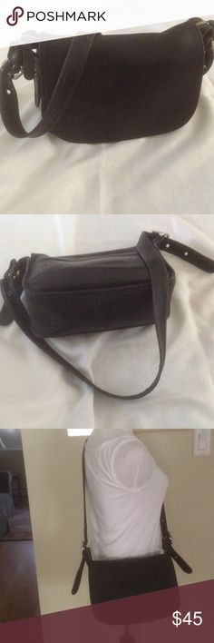 Coach Shoulder Bag Beautiful black leather classic Coach Saddle Bag style shoulder bag!  Adjustable straps on both sides, zippered under flap, with side pocket.  This is a go anywhere staple! Coach Bags Shoulder Bags