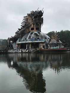Gone glory: Ho Thuy Tien Water Park's aquarium in Vietnam features a huge dragon, which is now covered in rust and peeling paint.