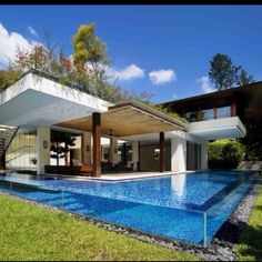 covered patio and see through glass pool
