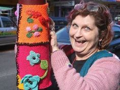 Yarn-bomber Leanne Lonergan with one of her team's urban woolly creations.