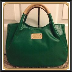 """✨BNWT✨ KATE SPADE Fulton Street Treesh Pine Purse This BNWT Kate Spade Fulton Street Treesh pine green handbag will be your go-to Spring bag!! This kelly green bag is coated canvas w/ tan leather trim & is an elbow hold or carry by hand w/ top magnetic snap closure.  The interior is just as cute w/ black & white polka dot fabric lining, interior zip & double slide pockets w/ gold-tone hardware & 4 protective metal feet on the bottom. Grab this one fast, it's sold out!  Measures 9.4""""h x…"""