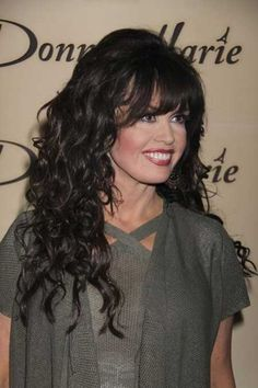 Black long hair with added volume and bangs