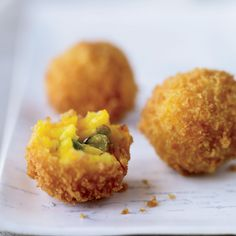 Toasted Pistachio-Cheese Arancini | These arancini are the size of tangerines, filled with creamy, cheesy rice, studded with nuts and green peas and encased in a great crunchy crust.