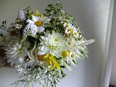 The Bride's bouquet of white waterlily type dahlias, lysimachia, feverfew, ox-eye daisies, astilbe and limonium.  Flowers by Honey Pot Flowers