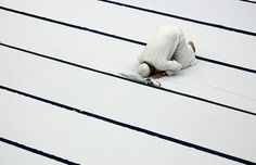 A Muslim man prays during a special prayer for peace in Gaza at a hall in Kuala Terengganu, Malaysia