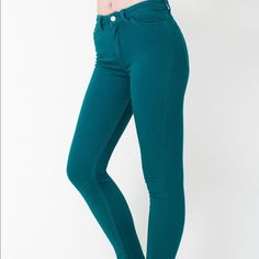 """American apparel teal high waisted riding jeans American apparel teal high waisted jeans. They are a side extra small. Very stretchy. 77% cotton 21% polyester 2% elastane. Waist 23"""" rise 10"""" inseam 30"""". Never been worn. American Apparel Jeans Skinny"""
