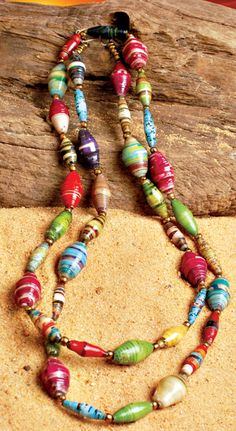 """Paper Bead Long Necklace.  We are all called to change the lives of those less fortunate. With this striking beaded necklace, you can do just that. Each bead is handmade from recycled paper by vulnerable women and refugees in Kenya making each necklace a unique symbol of hope. 40""""L.  SKU#: 2113324  Price: $29.00"""