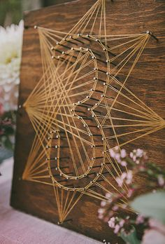 Brides.com: . Handmade string-and-nail table numbers.