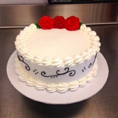 Buttercream single-tier with red buttercream roses #classic #carlosbakery