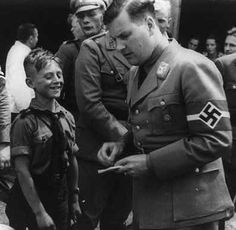 Baldur von Schirach with a member of the Jungvolk-The amount of time on religious instruction was reduced and it ceased to be a subject for school-leaving examinations and attendance at school prayers was made optional. Prayers written by Baldur von Schirach, the head of the Hitler Youth, that praised Adolf Hitler, were introduced and had to be said before eating school meals.