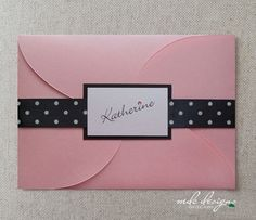Pink petalfolder Bat Mitzvah invitation with black & white polka dot ribbon and pink crystal.