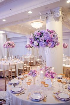 Wedding reception centrepieces in lilac purple white colours roses, event decor ombre style