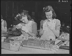 Young women at a Kentucky production plant. 1942. Photogrammar: Yale Collection of over 170,000 photographs from 1935-1945 from the U.S. Farm Security Administration