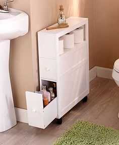 Add storage to your bathroom without taking up too much space with this slim organizer. This rolling organizer has 2 drawers and an open shelf for toilet paper, toiletries and more. A hidden hold