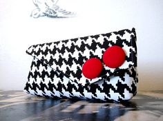 Black and White Houndstooth Pocket Clutch.  By dishhandbags on etsy (36 dollars)